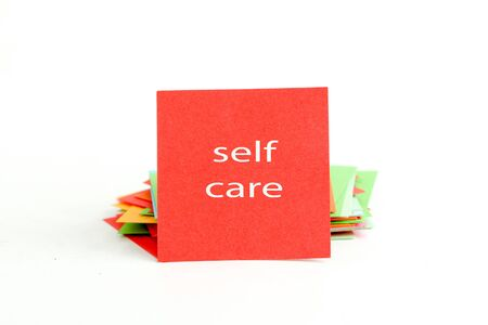 self care: picture of a red note paper with text self care