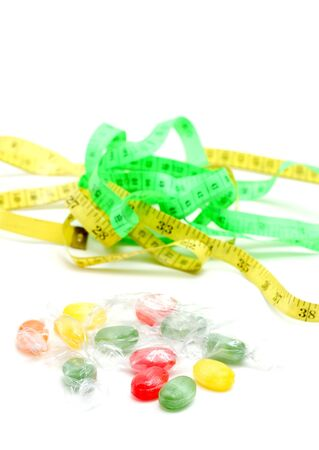 picture of a the colored fruit taste candies. and tape measure .sweet food concept Stock Photo