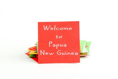 new guinea: picture of a red note paper with text welcome to papua new guinea Archivio Fotografico