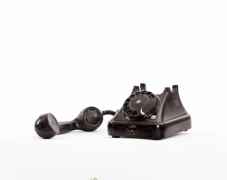 picture of an old black phone on white Stock Photo