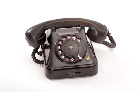 bakelite: picture of an old black phone on white Stock Photo