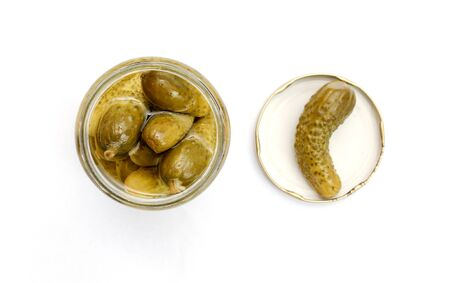 encurtidos: picture of a glass jar with pickled cucumbers on white background Foto de archivo
