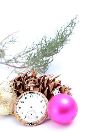 christmastime: picture of a Christmastime with vintage clock, baubles and cone