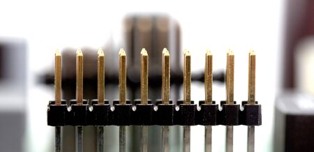 Detail of an electronic printed circuit board with many electrical components.shallow dof
