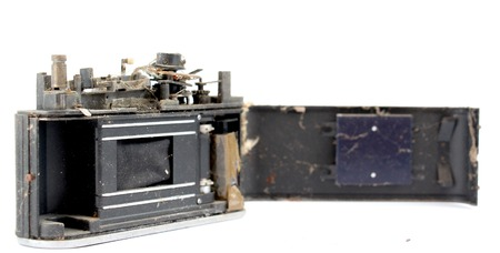 decomposed: image of an Old dirty nd dusty vintage camera on white background Stock Photo