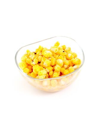 granule: image of a Boiled corn seeds on white background Stock Photo