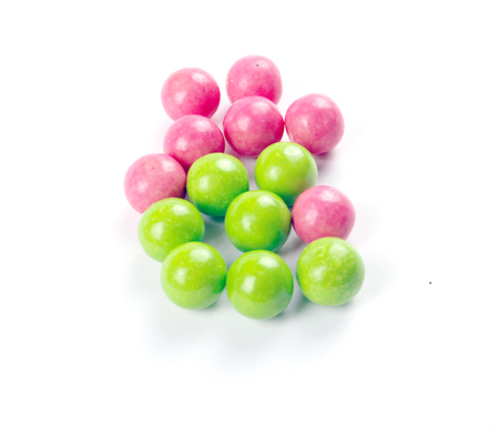 pink and green gumballs on a white background. Stock Photo