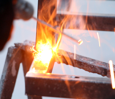 Sparks and jets of smoke when welding of steel structures,image of a