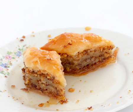 Homemade turkish baklava with walnuts and syrup,image of a