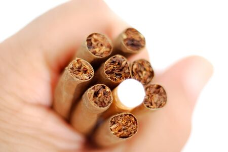 hand holding Cigarillos and cigarette , image of a