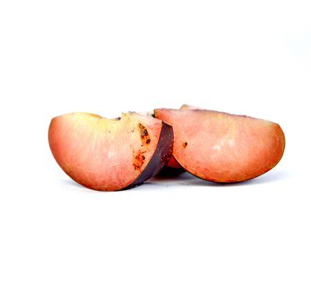 Plum slice with larva ,rottening fruit,image of a Stock Photo