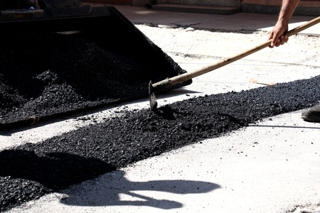 Repair of road or street surface,