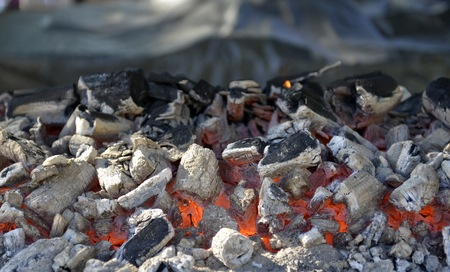 fireplace: BBQ Grill Pit With Glowing And Flaming Hot Charcoal Briquettes, Food Background Or Texture, Close-Up, Top View