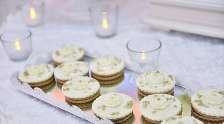 Wedding cupcakes on a well decorated table