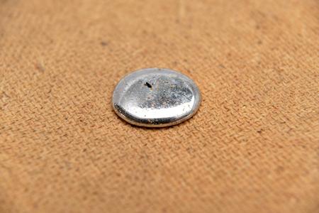 dusty drops of a mercury on a wod background