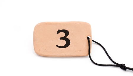 number on , brown ceramic plate ,necklace, on white background Stock Photo