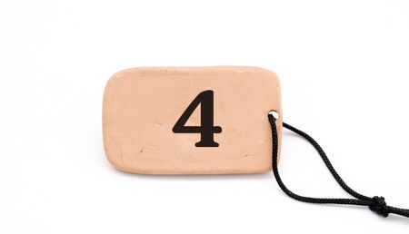 number on , brown ceramic plate ,necklace, on white background,image of a Stock Photo