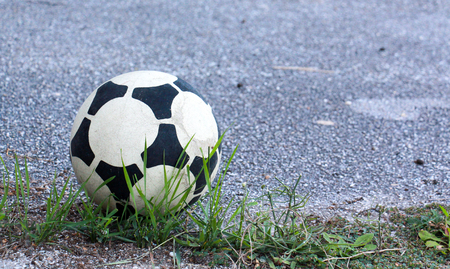 soccer ball on an old asphalt road, image of a Stockfoto - 105957878
