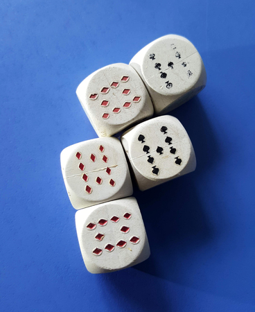 white dices with playing cards symbols on ble background,image