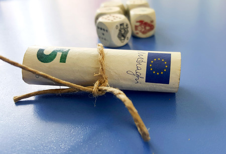 rolled euro banknote on a blue background,image of a