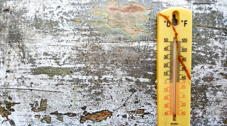 old thermometer on an wood background,image of a
