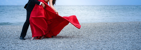 unrecognizable bride and groom dancing on the beach,image of a