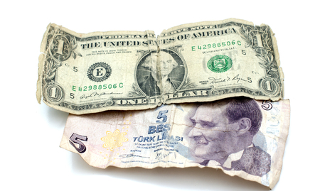 old dollar bill and turkish lira on white background,image of a Stock Photo