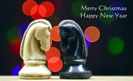 chess horse on a bokeh background, christmas card ,image of a Banque d'images
