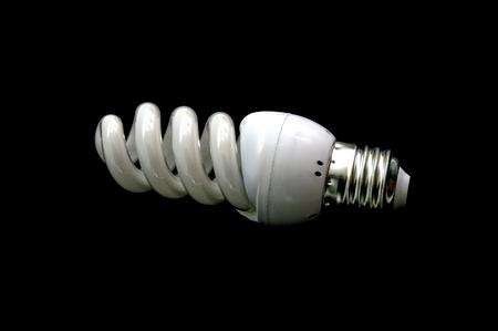 energy saving new lightbulb on black Standard-Bild - 114606873