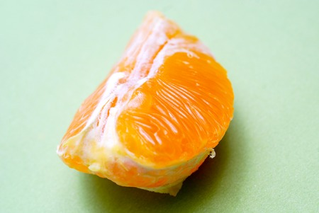 orange fruit slice on green