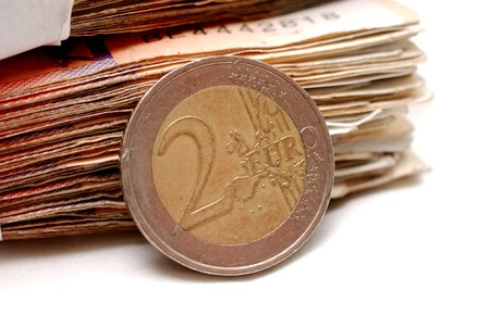 two euro coin on a banknote background 版權商用圖片 - 116370045