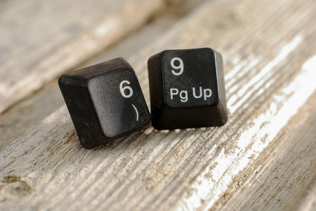 sexy numbers 69 computer keyboard buttons on old wood background, image