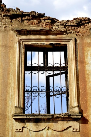 windows of an old abandoned ruinied buliding, image Stock Photo