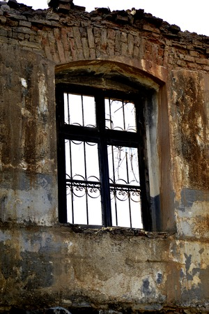 windows of an old abandoned ruinied buliding,
