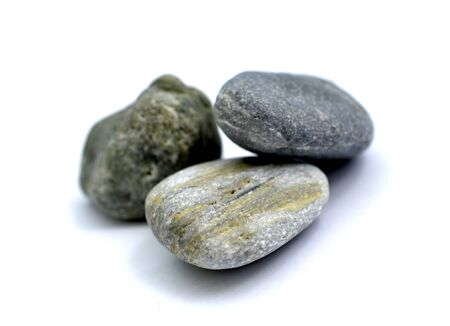 stone from the beach pictured in studio on white background,image
