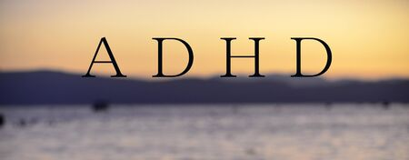 text adhd on blurred sunset background Stockfoto