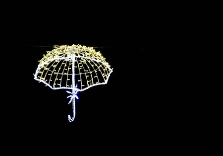 illuminated fluying umbrellas, christmas decoration in the city.