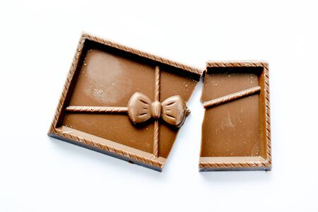 sweet chocolate pieces on white background,