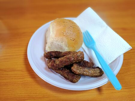 kebap and bread with sesame seeds on a disposable plate 写真素材