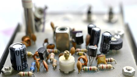 Dusty and dirty vintage electronics background with resisters, capacitors,diodes and other components. Reklamní fotografie