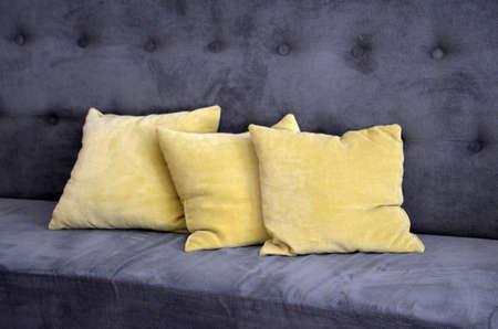 gray sofa with yellow brown pillows image