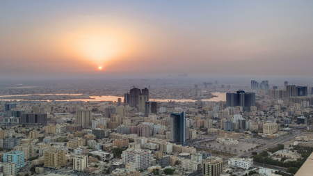 Sunrise with Cityscape of Ajman from rooftop timelapse. Ajman is the capital of the emirate of Ajman in the United Arab Emirates. 4K Stok Fotoğraf