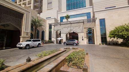 AJMAN, UAE - SEPTEMBER 2016: Entrance to Building of luxurious 5-star hotel in Ajman timelapse nestled near the turquoise waters of Arabian Gulf, UAE.