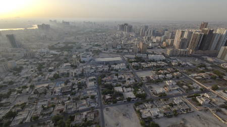Cityscape of Ajman from rooftop morning after sunrise timelapse. Ajman is the capital of the emirate of Ajman in the United Arab Emirates. 4K