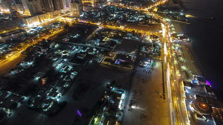 Panoramic Cityscape of Ajman with traffic on road from rooftop after sunset with lights timelapse. Ajman is the capital of the emirate of Ajman in the United Arab Emirates. 4K Stok Fotoğraf