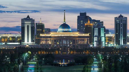 Panorama of the Astana city day to night transition timelapse and the presidents residence Akorda with park. View from the Palace of Peace and Reconciliation. Astana, Kazakhstan. 4K