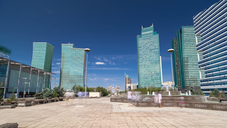 Fountain on Water-Green Boulevard timelapse hyperlapse, Nurzhol Boulevard is the national boulevard of Kazakhstan, a pedestrian area in the new business and administrative centre of Astana. Blue cloudy sky at summer day Stock Photo