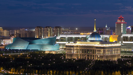 Akorda - residence President Republic of Kazakhstan and Central Concert Hall at night timelapse. Top view from roof. Evening illumination