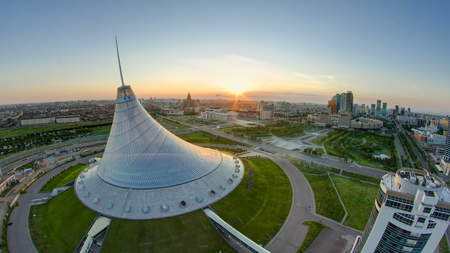 ASTANA, KAZAKHSTAN - JULY 2016: Elevated view with sunrise over the city center with Khan Shatyr and central business district transition Timelapse before sunrise time from rooftop, Kazakhstan, Astana, Central Asia 4K Editorial