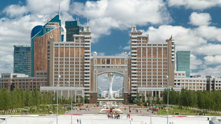 New business district timelapse with traffic on road and park with fountain from stairs Khan Shatyr in the capital of Kazakhstan in Astana.